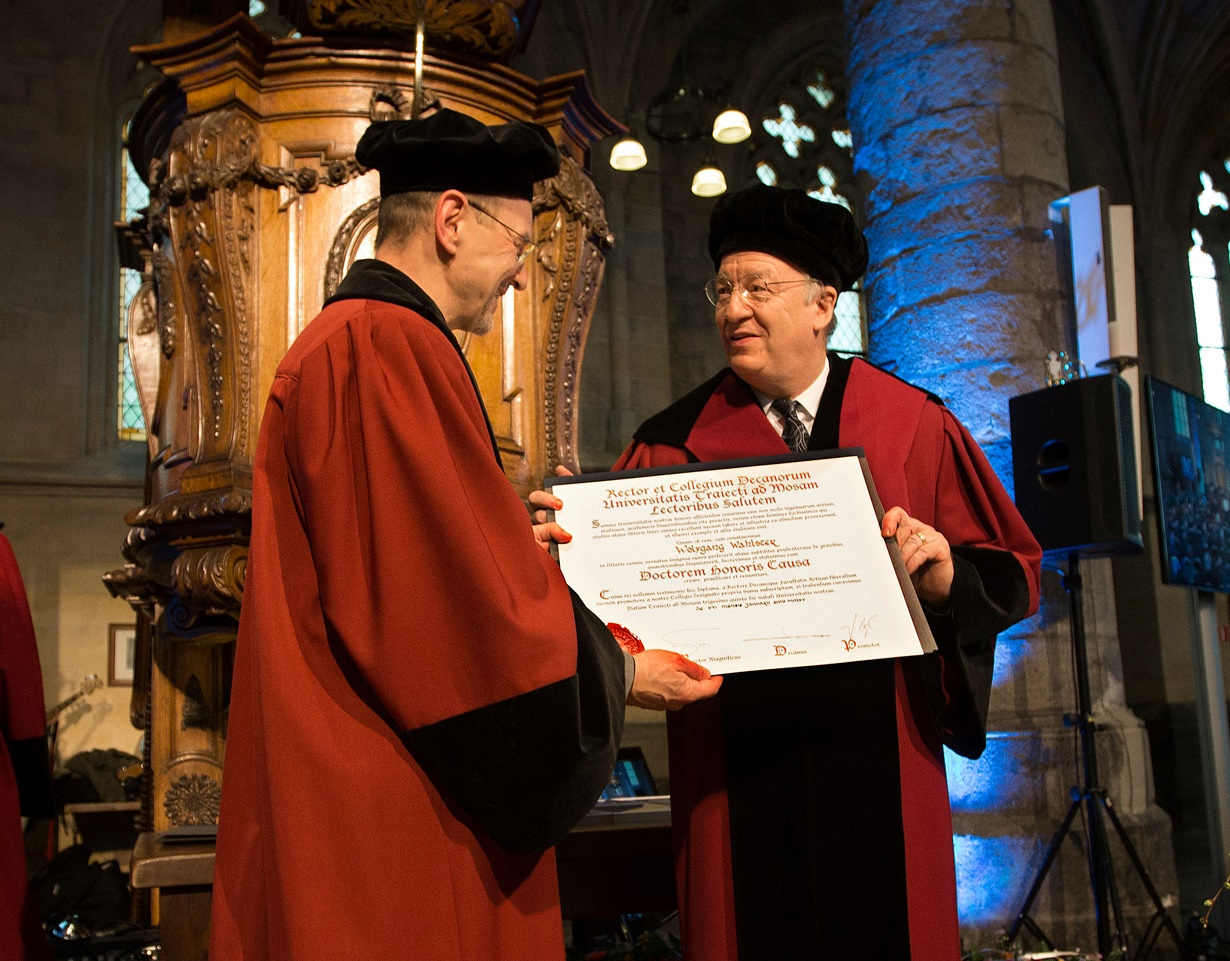 Prof. Weiss hands over the PhD                                                   certificate to Prof. Wahlster